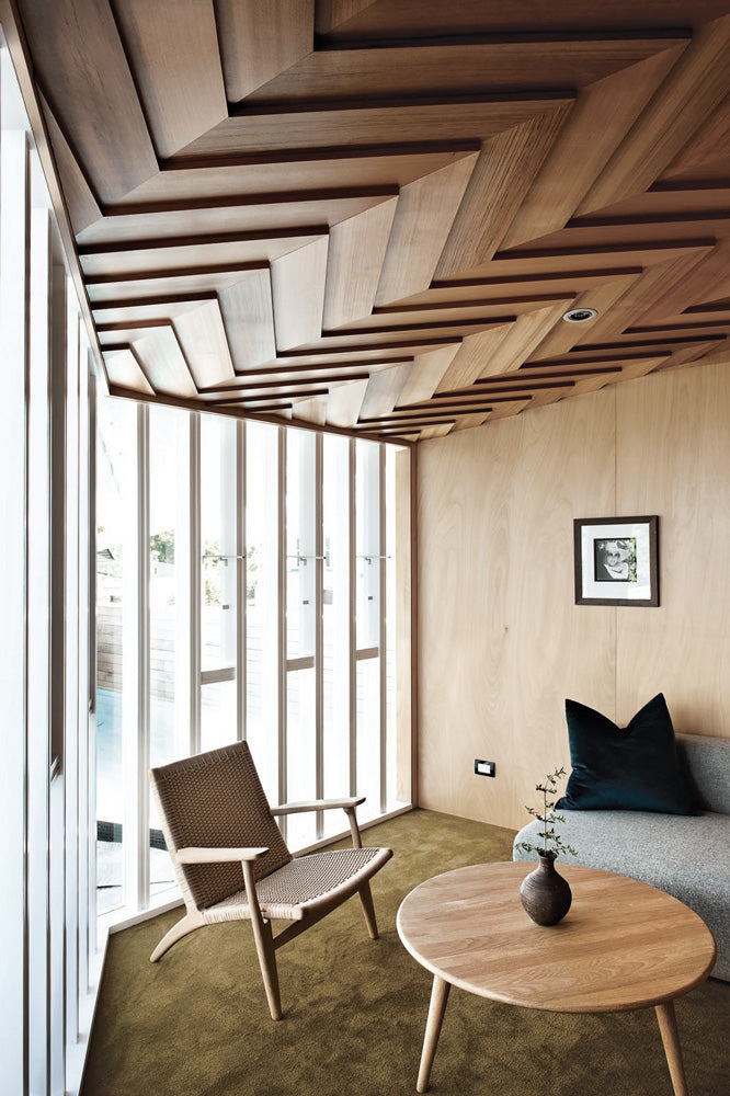 Warm interior design with light wood walls and statement ceilings