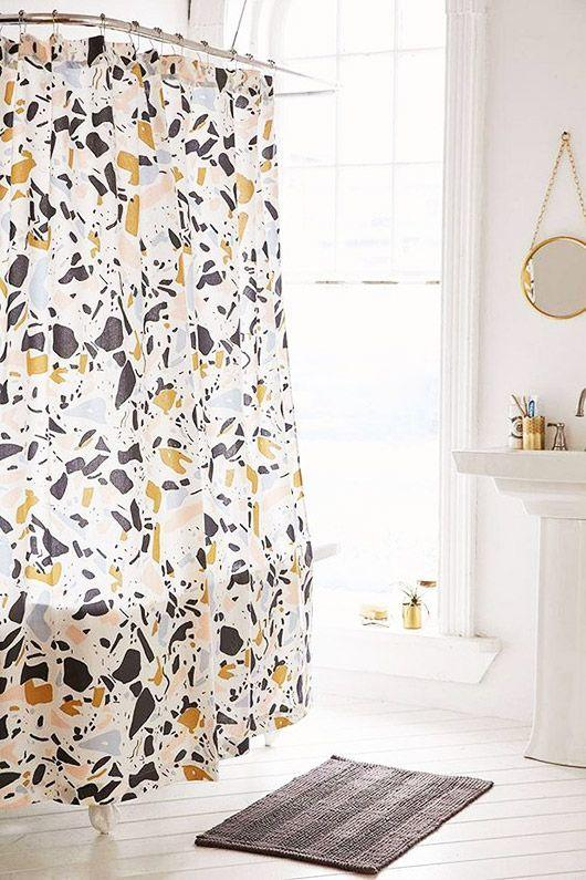 Terrazzo pattern shower curtain in white bathroom