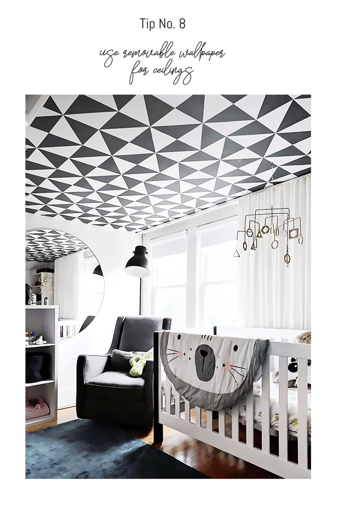 Simple pattern wallpaper on ceilings in black and white nursery designed by Crystal Sinclair designs