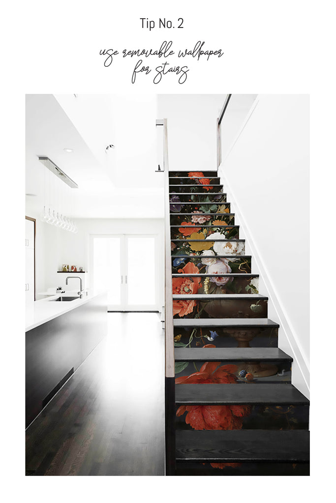 Light interior kitchen and dark wood stair covered with floral stickers