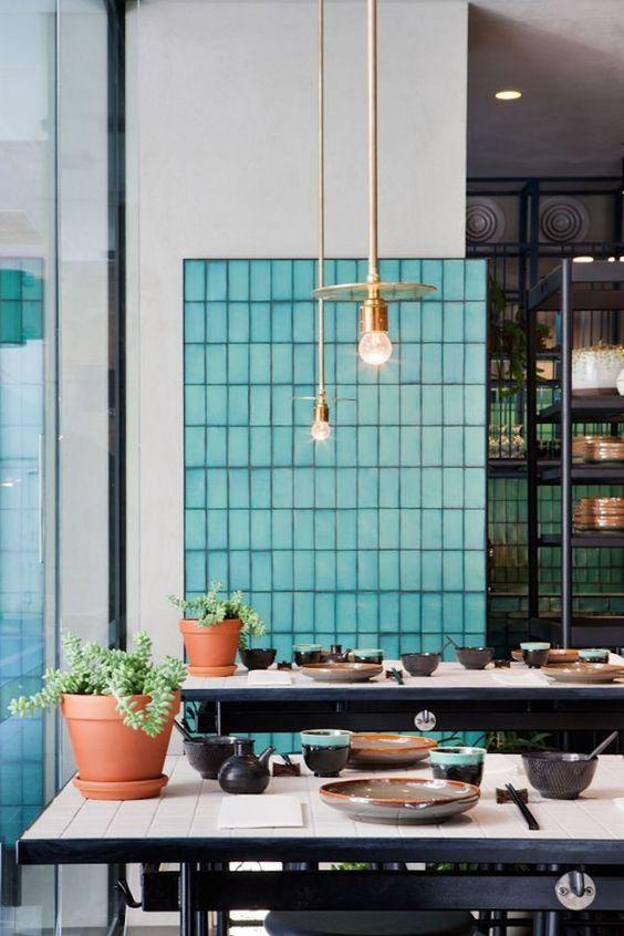 Colorful tile grout accent wall in restaurant interior