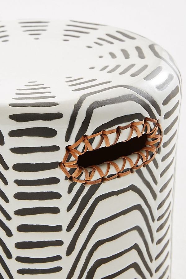 Tribal bohemian stool in black and white colors for scandi boho bedroom interior.