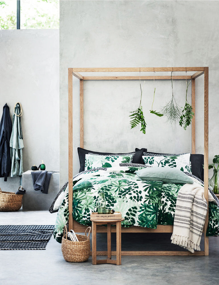 Minimal interior design with urban jungle style bedding