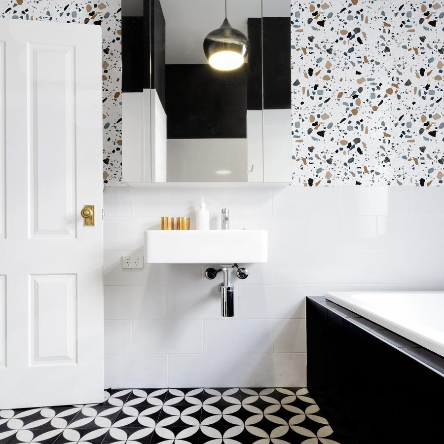 Coastal style bathroom featuring removable wallpaper