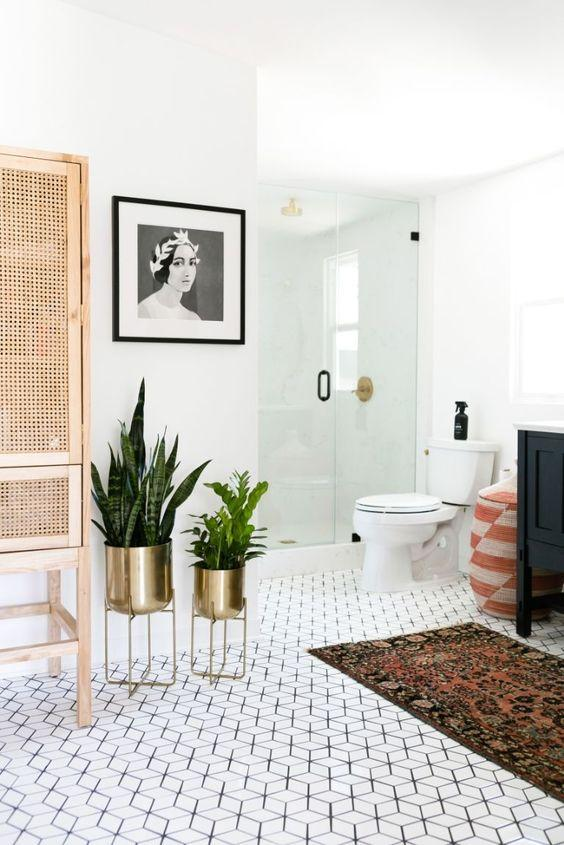 Mid-century modern plant stands in a chic bathroom interior