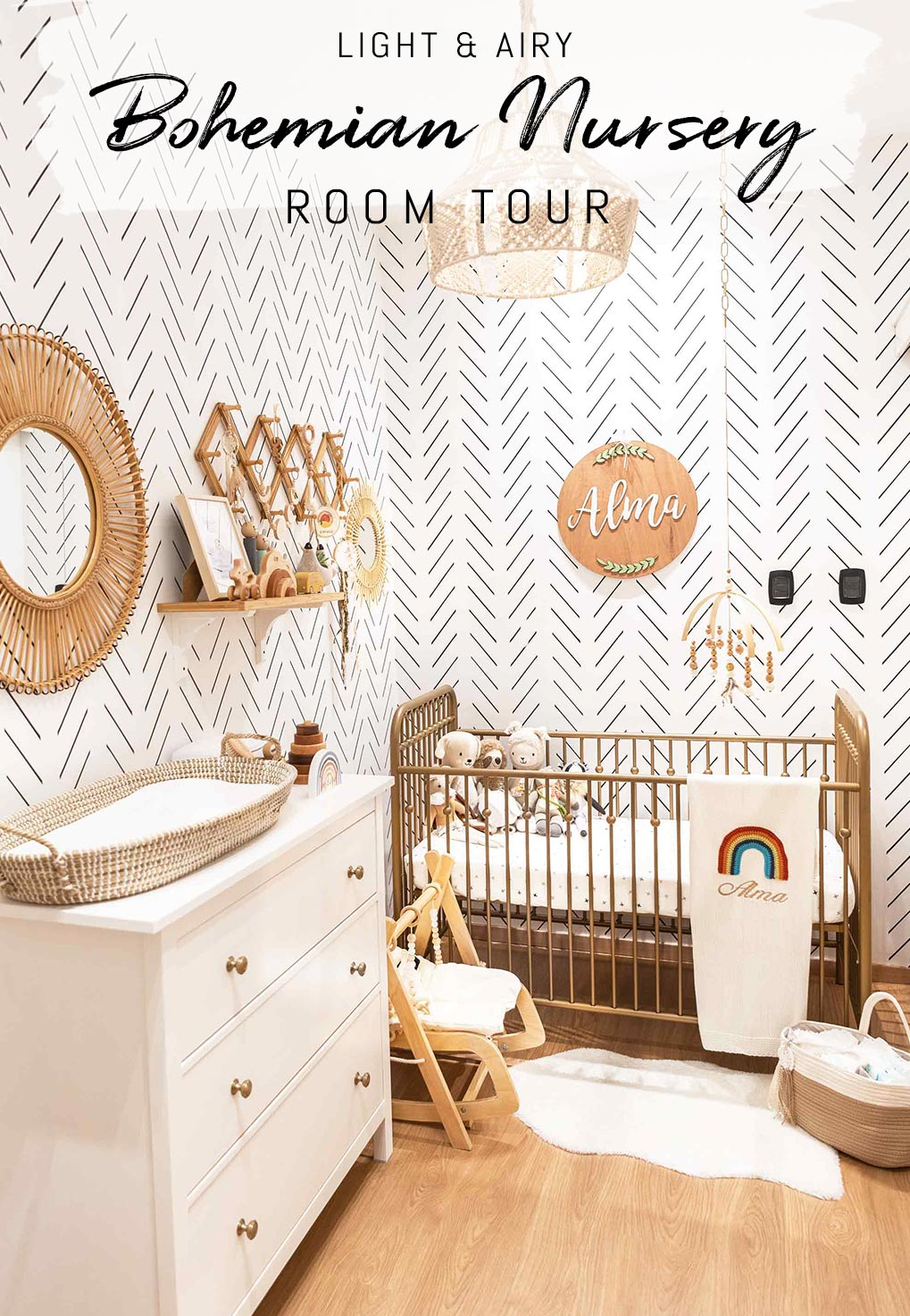 White and wood tone baby nursery interior with herringbone livettes wallpaper