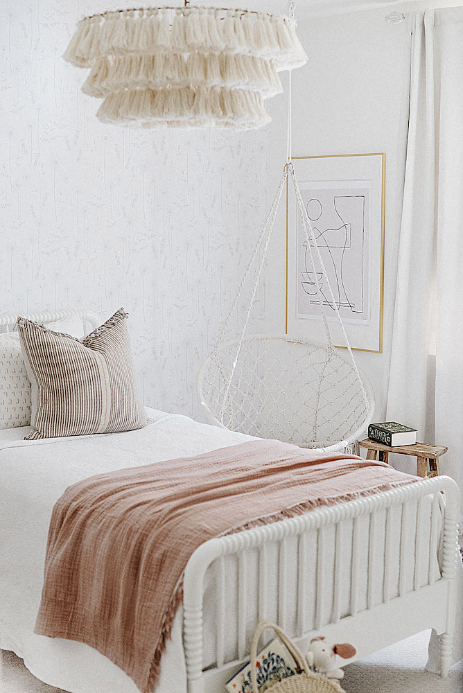 Beautiful bohemian girls bedroom interior with white an blush pink color scheme and wildflower design removable wallpaper