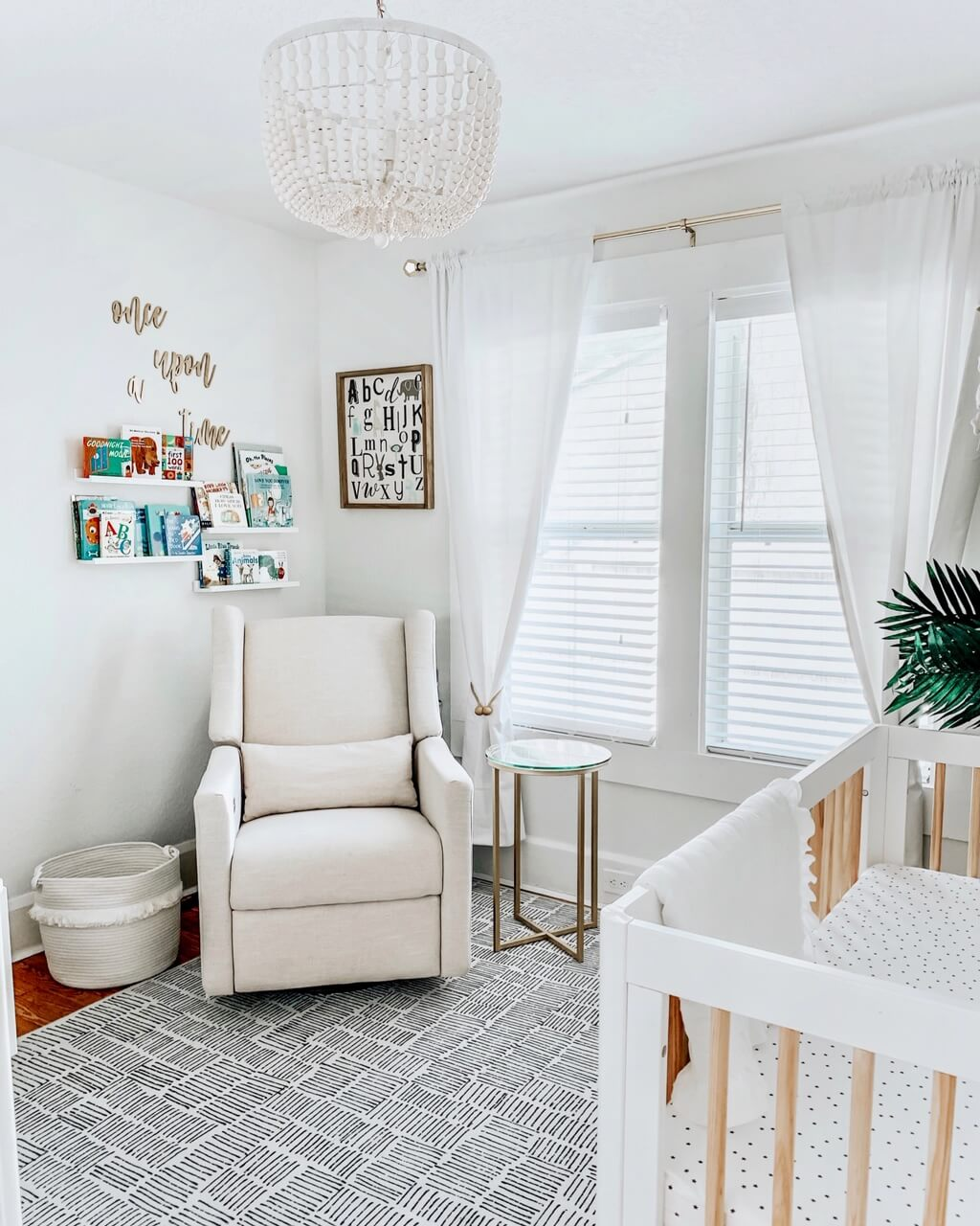 Dreamy white bohemian nursery design with pattern area rug