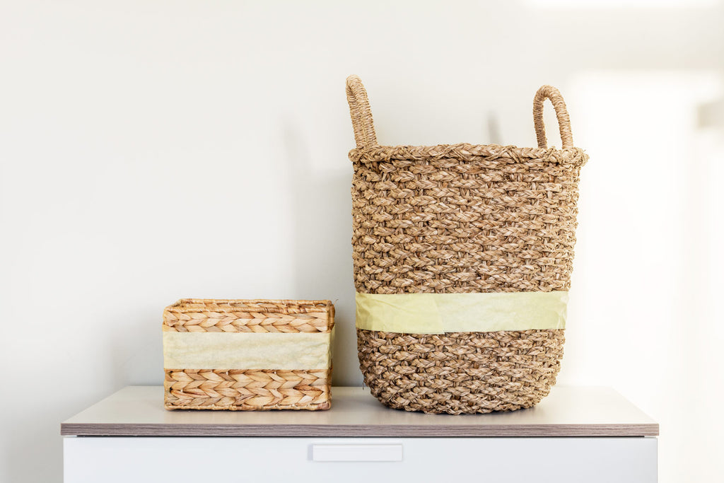 Paint dipped wicker baskets.