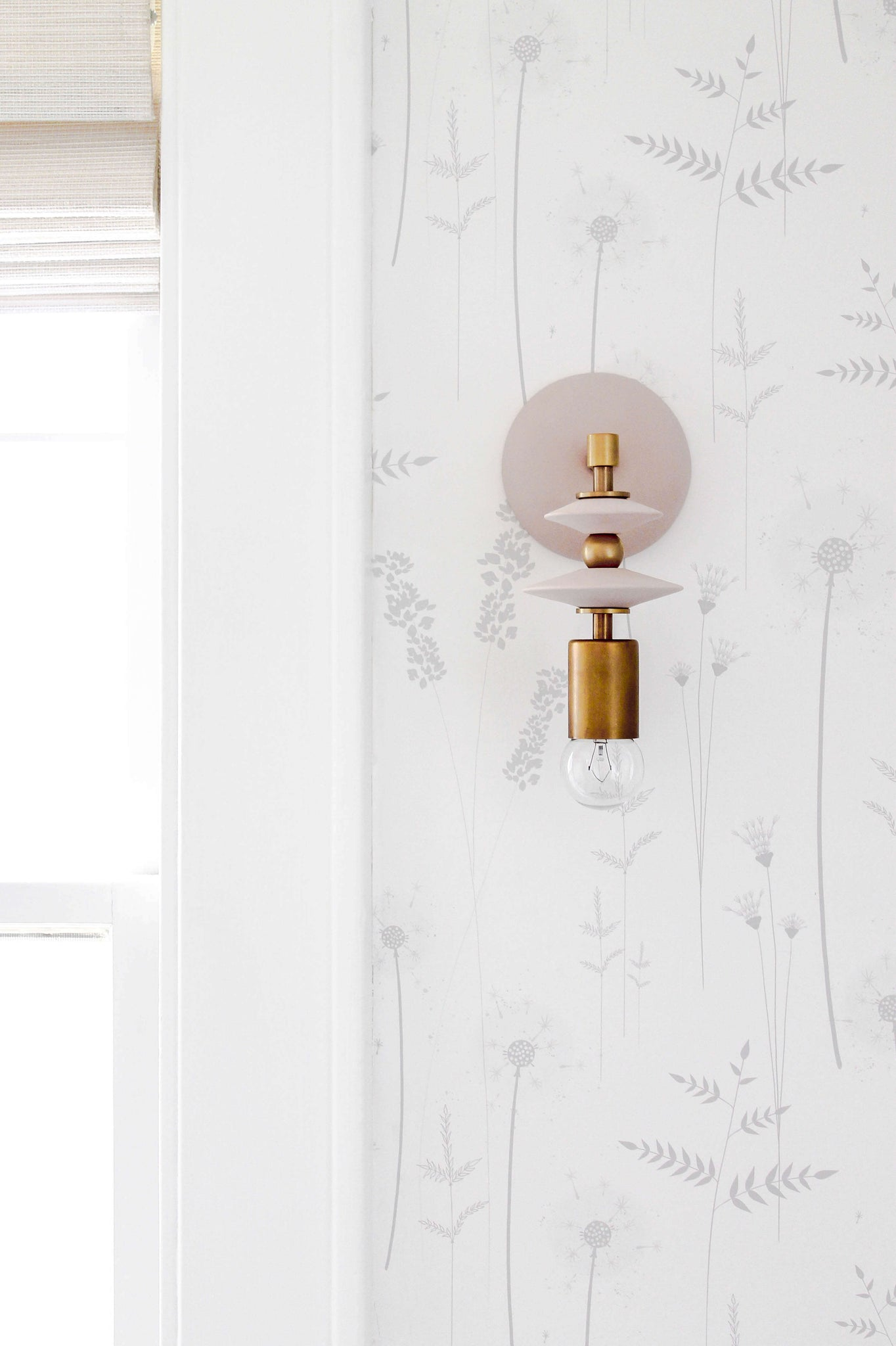 Modern geometric mid century wall sconces with blush pink and brass colors