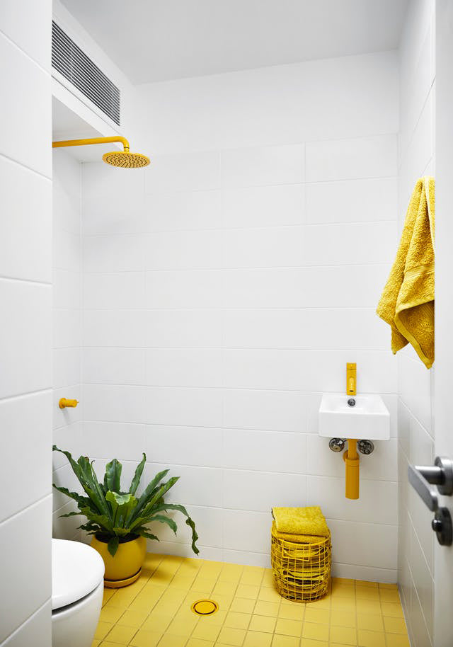 Light bathroom with white and yellow accents