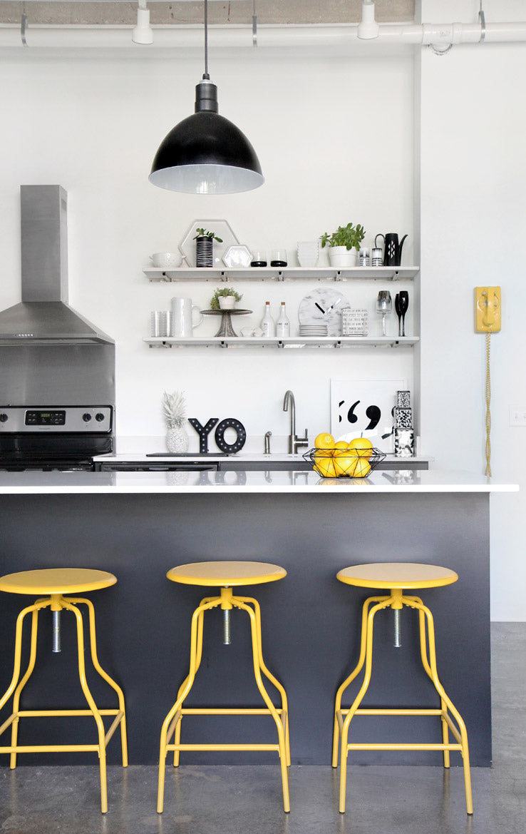Yellow accents in Scandinavian design kitchen by Jenni Radosevich