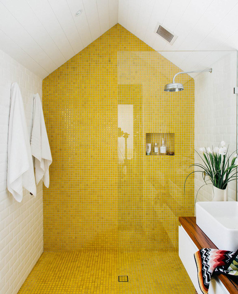 Light bathroom interior with white and yellow tile combination