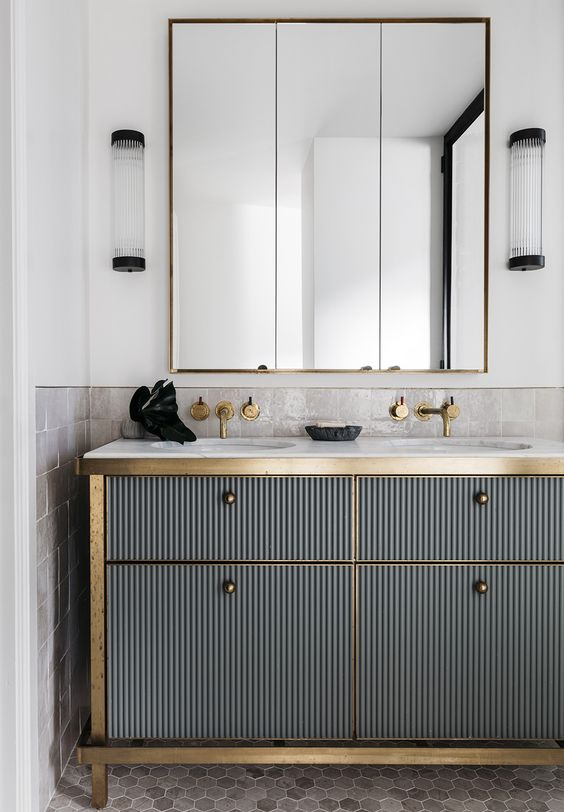 Modern art deco powder room with gold details