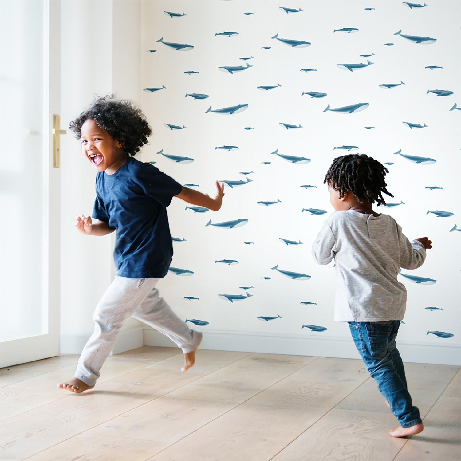 blue whales wallpaper and two boys