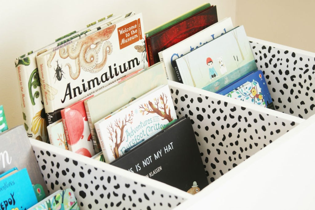 DIY nursery book bin with removable wallpaper