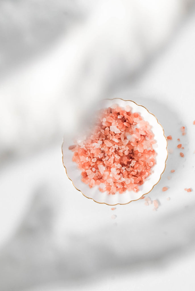 Trendy bathroom decor - pink salt and white decorative coral