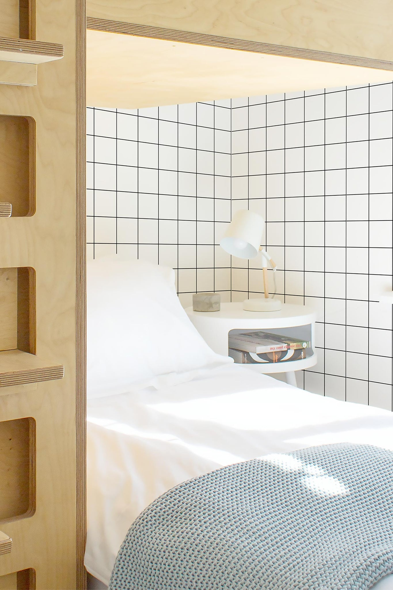 large checkers wallpaper in boys room interior
