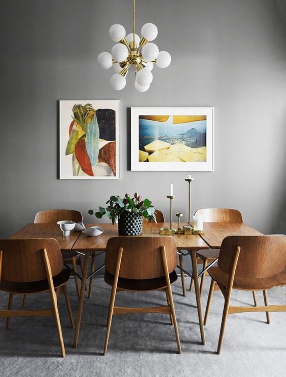 Minimalist mid-century modern dining room with grey walls and teak furniture
