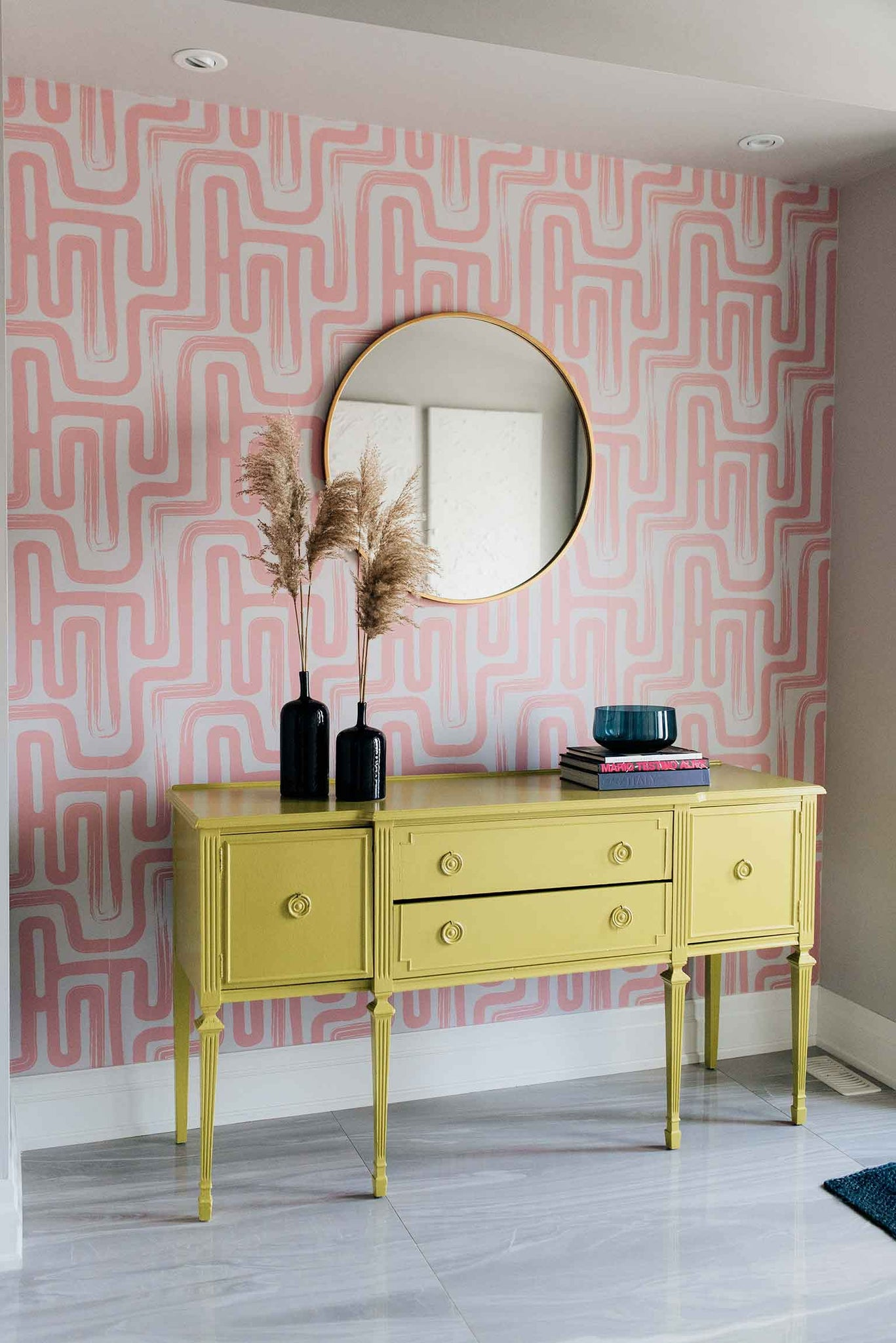 Pink eclectic entryway interior design with bold removable wallpaper