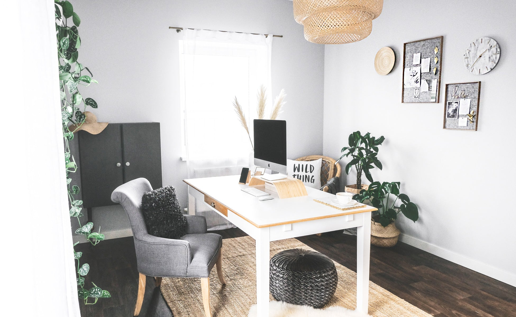 Minimalist bohemian office interior with grey color palette and gold accents