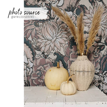 Pink paisley print removable wallpaper in bohemian home interior setting with pampas grass and pumpkin decors
