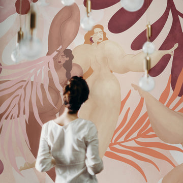 Nude wall mural of female figure in pink and red color palette