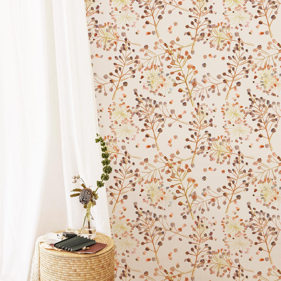 Autumn color palette removable wallpaper in bohemian girl's room with flowers and rattan furniture