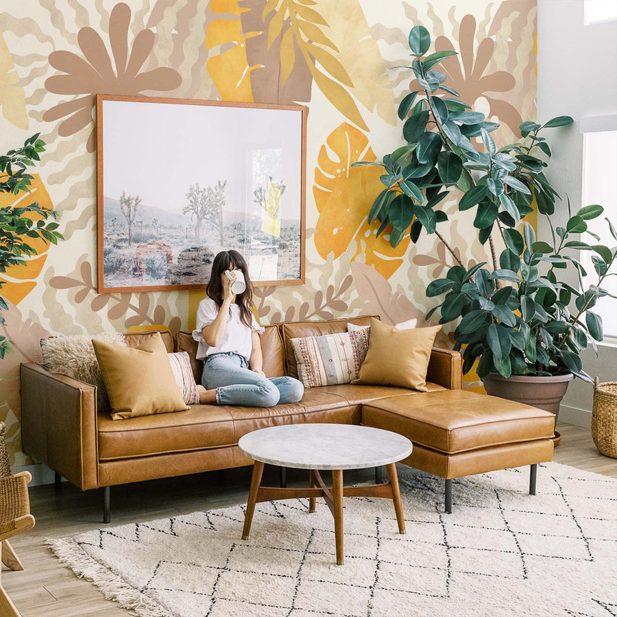 Bohemian jungle themed wall mural in boho style living room interior