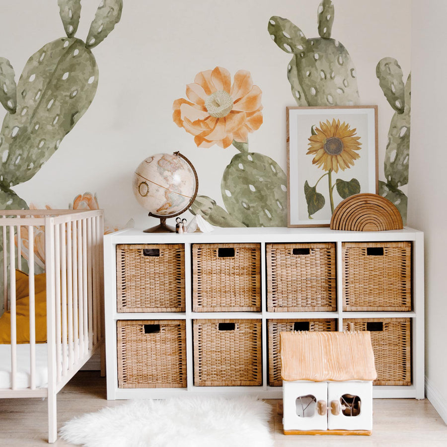 Oversized bohemian style cactus wallpaper for kids nursery interior in earth tones