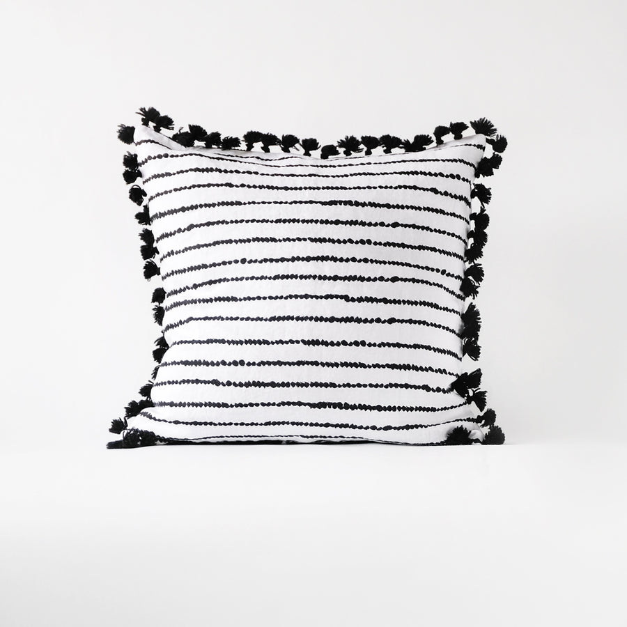 Dotted bohemian style washed linen pillow cover with black tassels