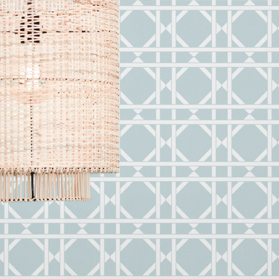 Cane pattern wallpaper in light blue color in boho interior