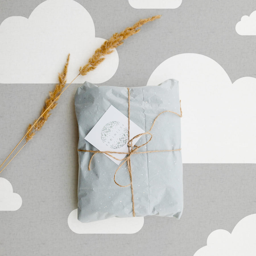 Grey and white clouds removable wallpaper for travel inspired kid's room interior