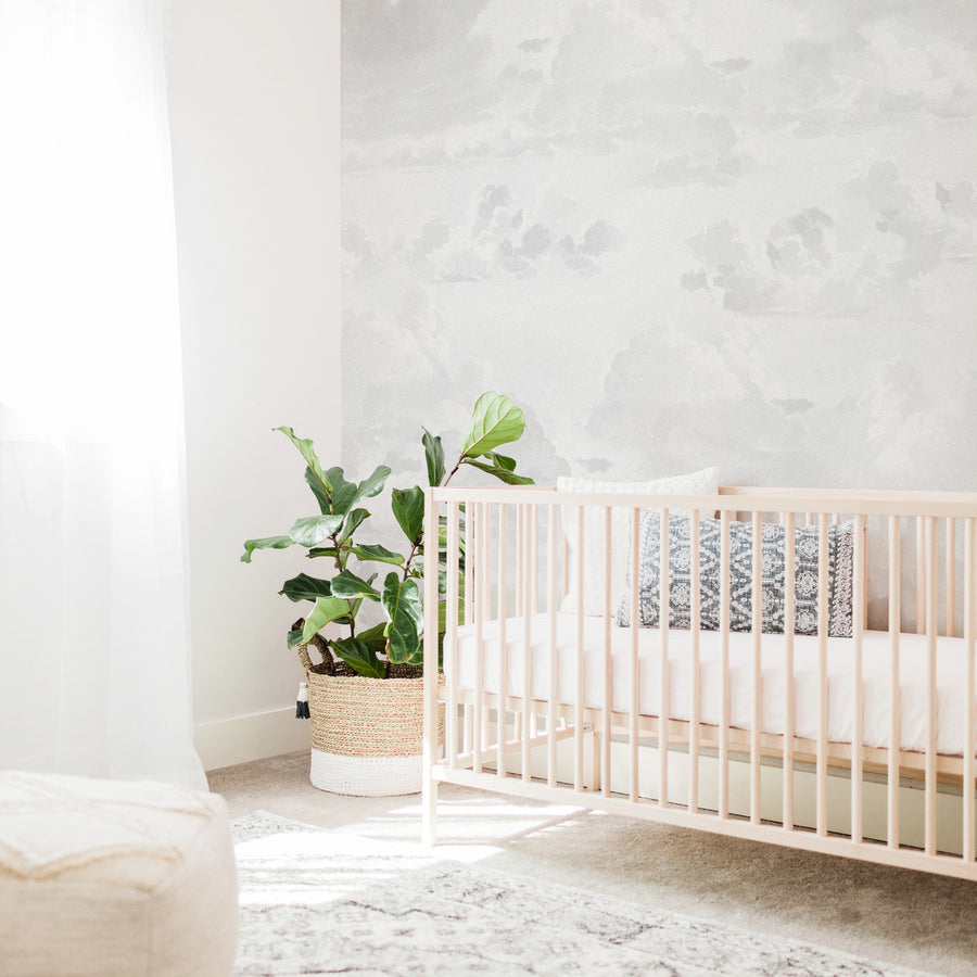 Gender neutral nursery interior with coastal style and vintage clouds removable wall mural wallpaper