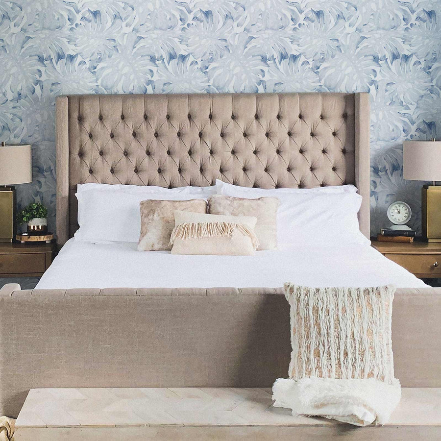 Modern coastal style meets farmhouse bedroom interior with blue tropical removable wallpaper