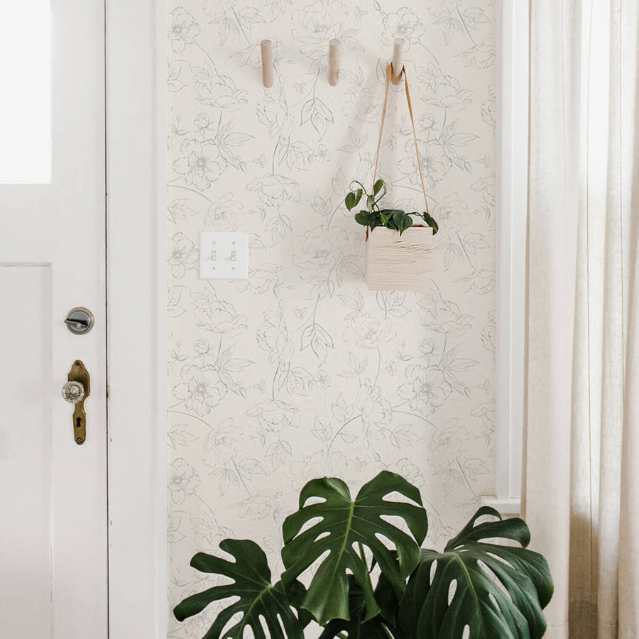 Boho style entryway interior with subtle design floral removable wallpaper and greenery decor
