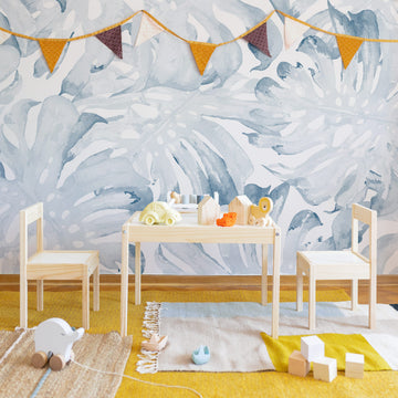 Coastal eclectic style kids playroom interior with oversized tropical wall mural