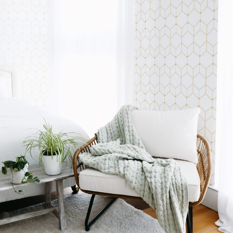 Faux gold color geometric design removable wallpaper in white boho bedroom interior