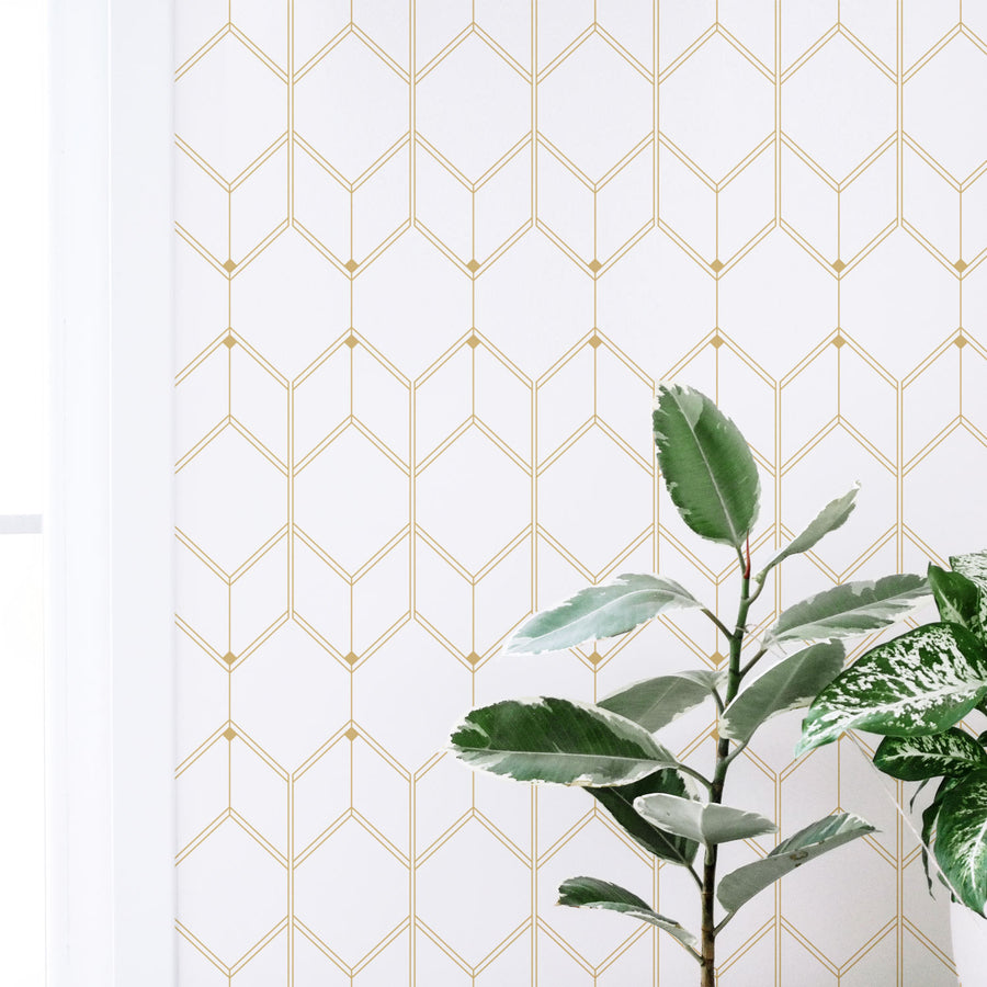 White and gold color removable wallpaper in light interior with greenery decor