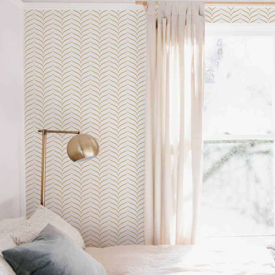 Modern chevron design removable wallpaper with faux gold color design in neutral bohemian bedroom interior