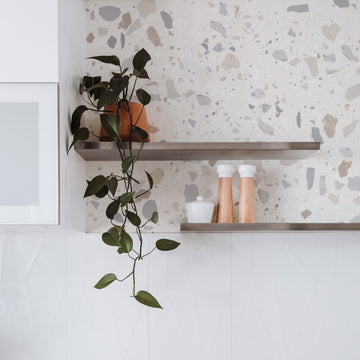 Neutral terrazzo design removable wallpaper in white bathroom interior