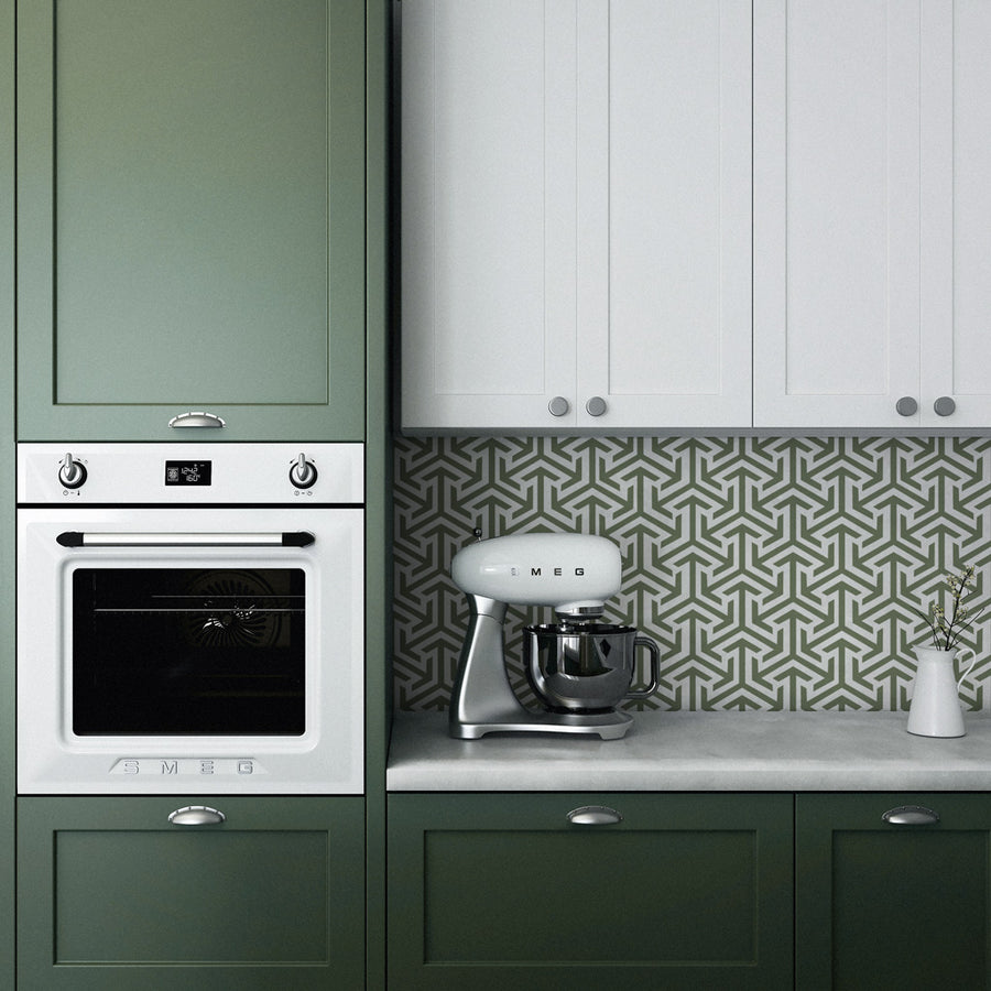Olive green kitchen interior with geometric removable wallpaper on backsplash