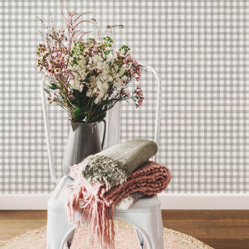 Grey watercolor gingham pattern removable wallpaper in bohemian interior with pink flowers and interior decor