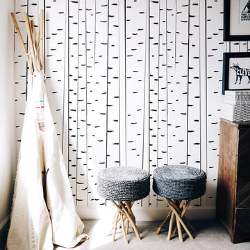 Modern birch tree removable wallpaper in kid's playroom with teepee and woodland animal decor