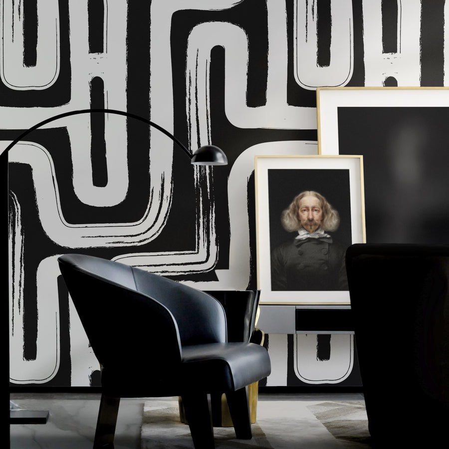 Moody interior setting with oversized black and white paintbrush design removable wallpaper