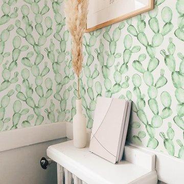 Faded design watercolor cactus design removable wallpaper in powder room interior