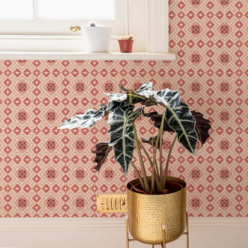 Pink moroccan tiles removable wallpaper in kitchen or bathroom interior with gold planter and cactus plants