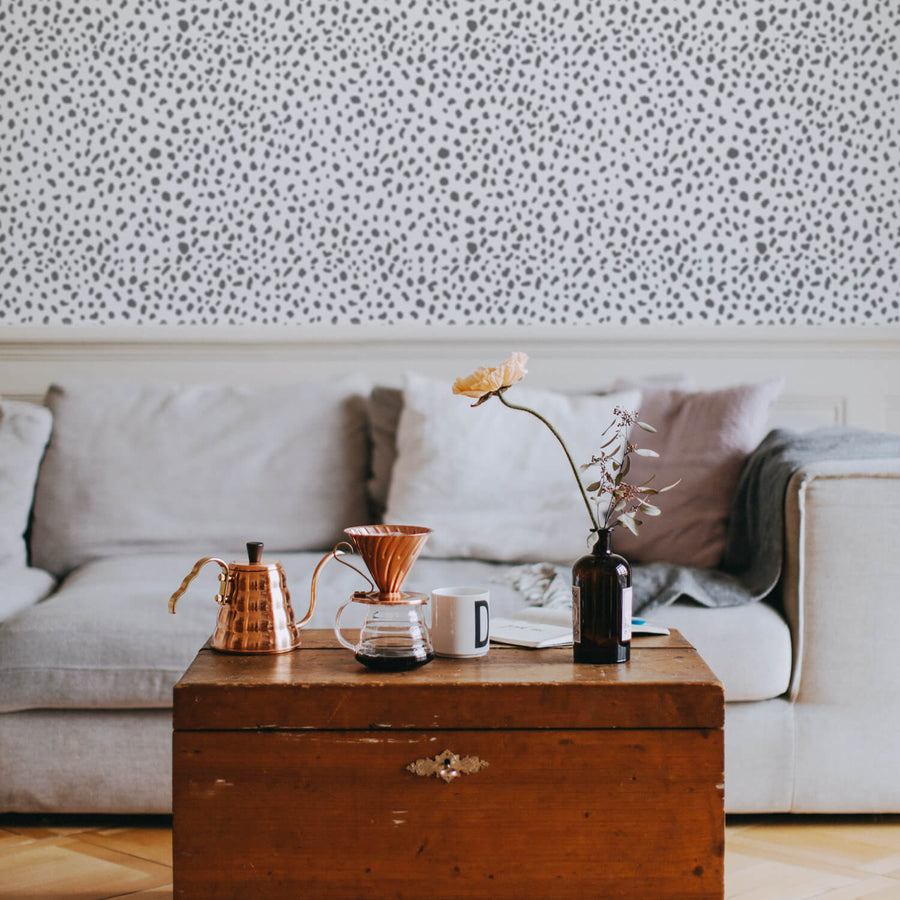 Grey dalmatian print removable wallpaper in neutral bohemian style living room interior