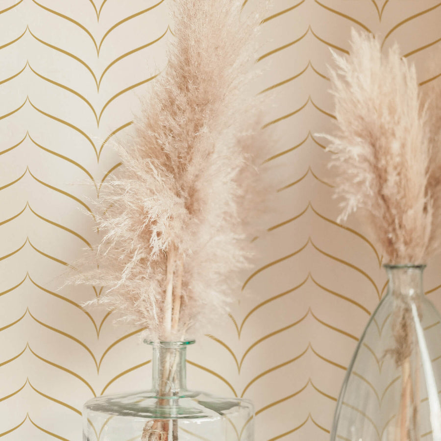 Gold chevron design removable wallpaper in boho style interior with pampas grass decor