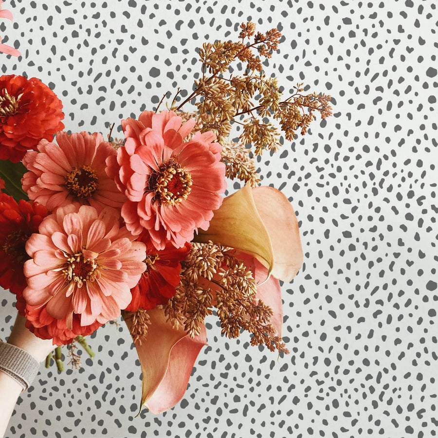 Grey animal print removable wallpaper as a backdrop for flower arrangement photography